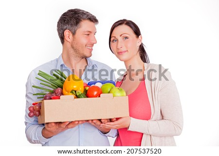 younger adults buying healthy food - stock photo