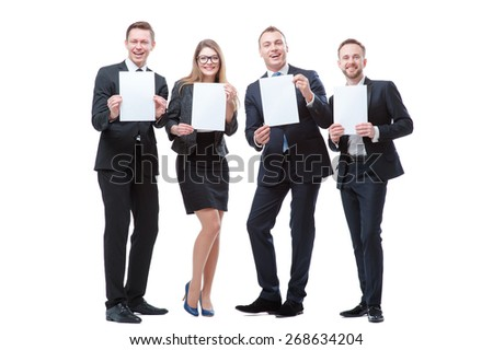 Your advertisement in good hands. Group of handsome young business people holding blanks with copy spaces. Isolated on white. - stock photo