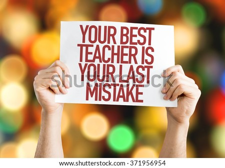 Your Best Teacher Is Your Last Mistake placard with bokeh background - stock photo