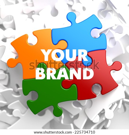Your Brand on Multicolor Puzzle on White Background. - stock photo