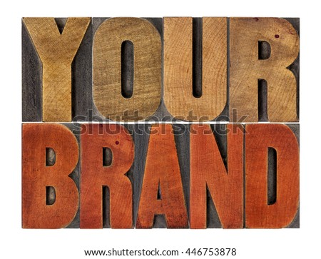 your brand word abstract- motivational concept in vintage letterpress wood type block