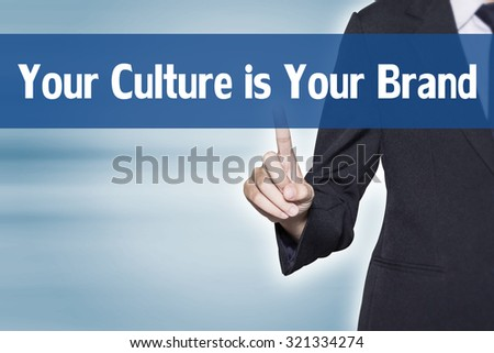 Your Culture is Your Brand Business woman pointing at word for business background concept - stock photo