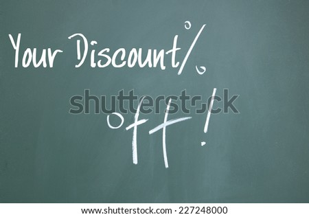 your discount sign on blackboard - stock photo