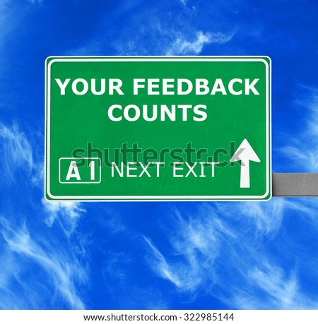 YOUR FEEDBACK COUNTS road sign against clear blue sky - stock photo