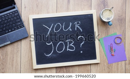 Your job written on a chalkboard at the office - stock photo