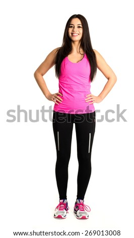 Your personal trainer: Attractive, young and fit woman (Asian/Caucasian mix) with long dark hair wearing sports clothing with shadows over a white background - stock photo