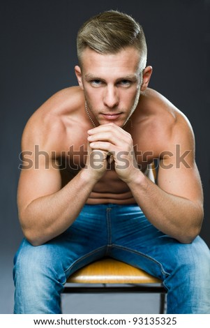 Your personal trainer, portrait of a very fit handsome young man. - stock photo