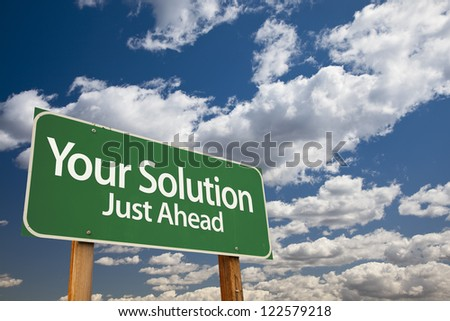 Your Solution Green Road Sign Over Dramatic Clouds and Sky. - stock photo