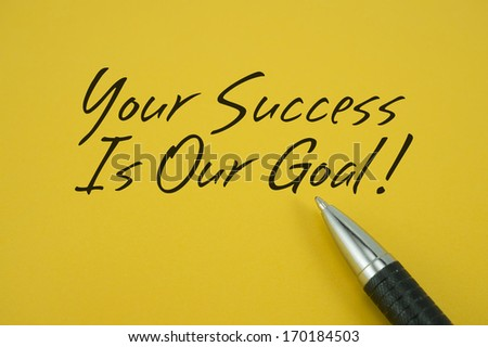 Your Success Is Our Goal note with pen on yellow background