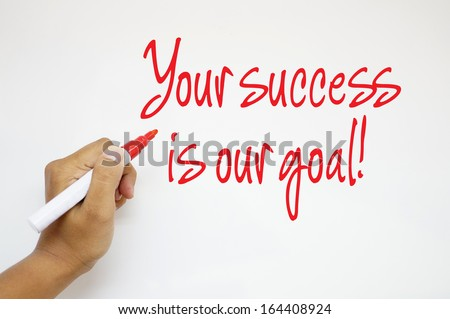 Your Success Is Our Goal! sign on whiteboard - stock photo