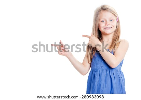 Your text here. Pretty little girl pointing copy space. Isolated on white. - stock photo