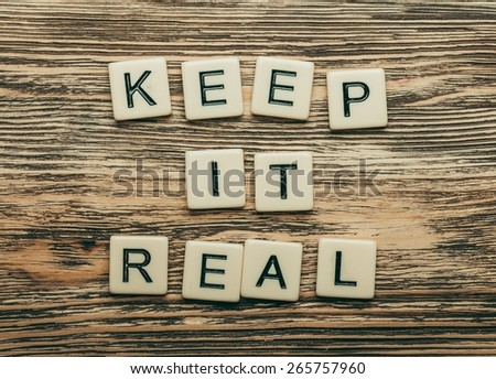 Yourself. Keep it real text on a wooden background - stock photo
