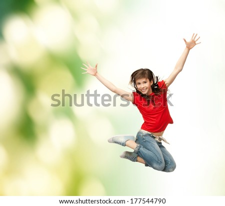 youth and fitness concept - happy girl jumping in the air - stock photo