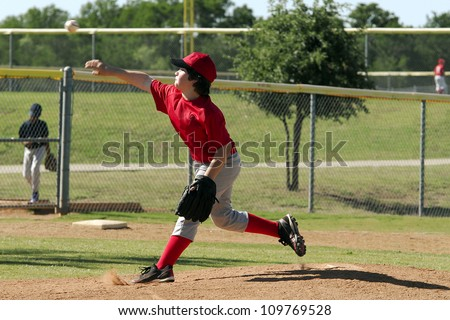 Youth baseball pitcher throwing a pitch - stock photo