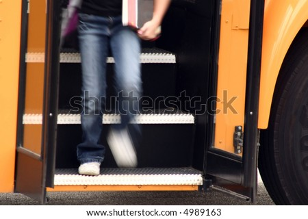 Youth getting off of school bus