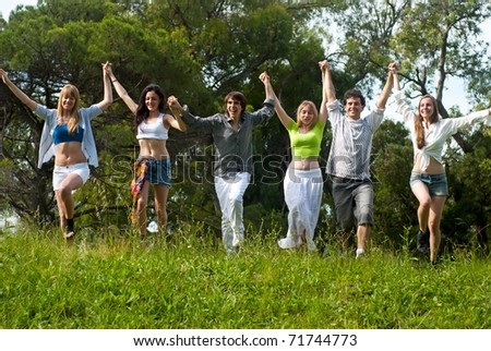 Youth group against the nature - stock photo