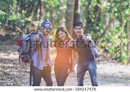 youth group thumb up vacation travel National Park,young people in autumn park,Young Asian Backpacker Camping Hiking Journey Travel Trek Concept. Camp Forest Adventure Travel Remote Relax Concept,
