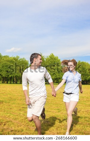 Youth Lifestyle Concept: Beautiful Caucasian Couple Having Their Outdoor Holiday Together. Vertical Image Composition
