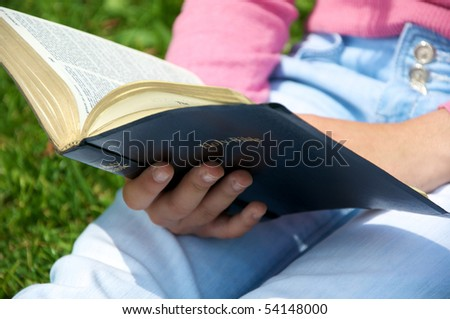 Youth reading the Bible