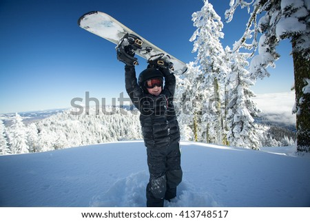 Youth snowboarder excited about the day