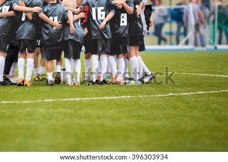 Youth Soccer Football Team Gathering Before The Tournament Final Match. Coach Giving Team Talk - stock photo