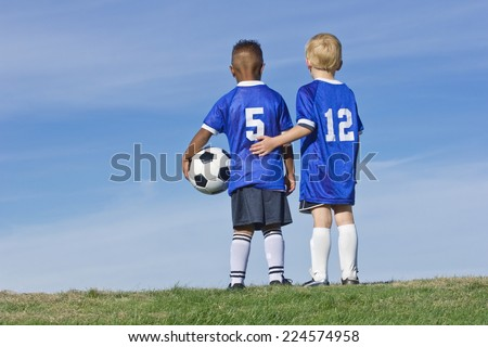 Youth Soccer Players standing together Rear View - stock photo