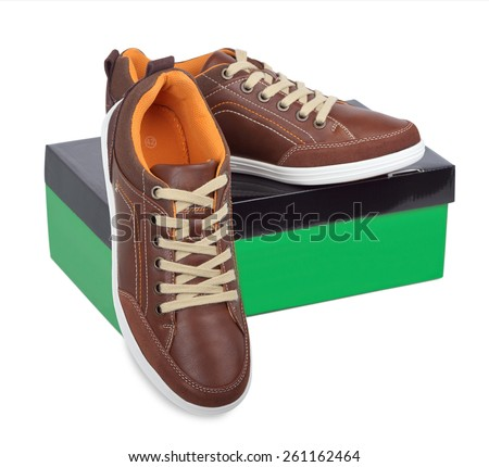 Youth sports shoes and packing box on a white background - stock photo