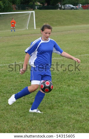 Youth Teen Girl Kicking Soccer Ball