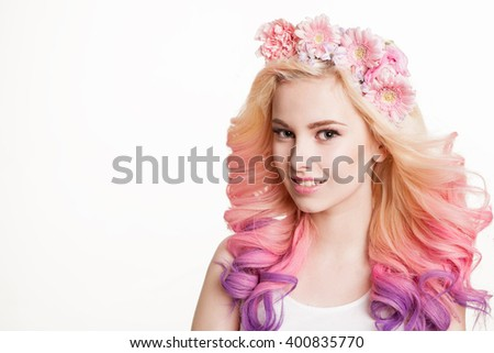 Youth women with colored hair smiling. Flowers in her hair. Studio, isolated, white background. Concept spring, summer. Look at the camera. Copyspace - stock photo