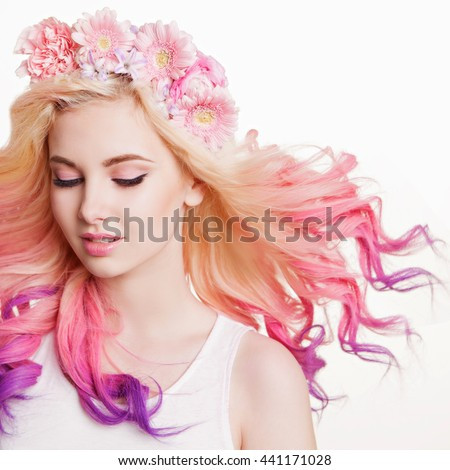 Youth women with curly colored hair and flowers. white and pink background. Beauty. Flying Hairs - stock photo