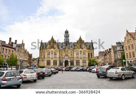 YPRES-BELGIUM-MAY 19, 2015: Main square in Ypres showing the City Hall building - stock photo