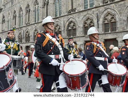 YPRES, BELGIUM-NOVEMBER 11, 2014: Participants of Poppy Parade commemorating 100 years of World War I depart from Grand Place to Porte de Menin or Gates of Menin - stock photo