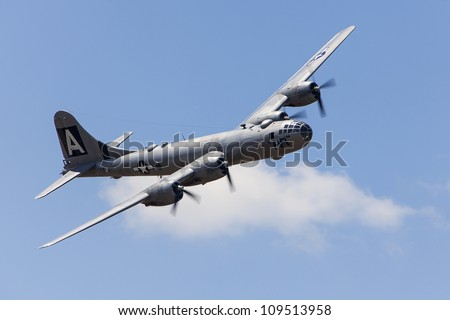 YPSILANTI - AUGUST 5 : The only flying B-29 bomber in the world makes a pass at the Thunder over Michigan air show  August 5, 2012 in Ypsilanti, Michigan. - stock photo