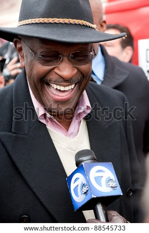 YPSILANTI, MI - NOVEMBER 10th: Presidential candidate Herman Cain laughs with reporters, November 10, 2011 in Ypsilanti, MI