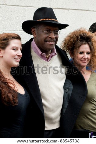 YPSILANTI, MI - NOVEMBER 10th: Presidential candidate Herman Cain poses with employees of Big Sky Diner, November 10, 2011 in Ypsilanti, MI