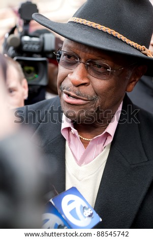 YPSILANTI, MI - NOVEMBER 10th: Republican Presidential candidate Herman Cain answers reporters questions outside of Big Sky Diner, November 10, 2011 in Ypsilanti, MI