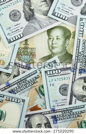 Yuan among one hundred dollars - stock photo
