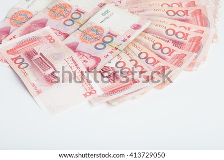 Yuan banknotes from China's currency. Symbolic example of spending money in shops, or advantageous purchase in the shopping center. Yuan notes from China's currency. Chinese banknotes - stock photo