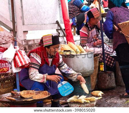 Yuan Yang , China April, 2015 .Miao nationality women sell street food, Yuan Yang It is well known for its spectacular rice-paddy terracing., Yunnan Province