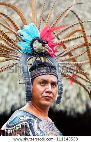 YUCATAN, MEXICO - AUGUST 15: Mayan Shaman during a traditional performance in the Hacienda La Guadalupana resort showing ancestral mayan cultures on August 15, 2012 in Yucatan, Mayan Riviera, Mexico - stock photo