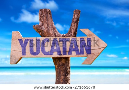 Yucatan wooden sign with beach background - stock photo