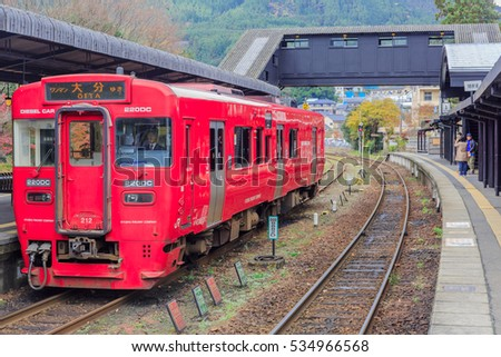 YUFUIN OITA - DEC,13 : The local red train at Yufuin Station where is the destination of tourist for looking the local village in Japanese style. Tourist visiting here everyday.JAPAN DEC,13 2016
