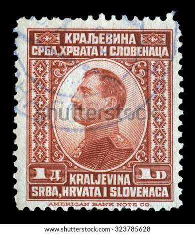 YUGOSLAVIA - CIRCA 1924: A stamp printed in Yugoslavia (Kingdom Serbia, Croatia and Slovenia) shows portrait of King Alexander I of Yugoslavia, series King Alexander I, circa 1924 - stock photo