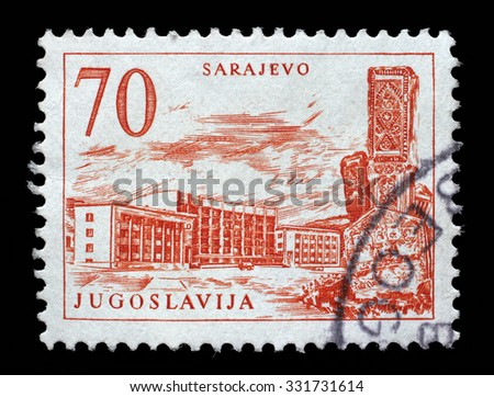 YUGOSLAVIA - CIRCA 1958: A stamp printed in Yugoslavia shows Sarajevo railway station and obelisk, Bosnia and Herzegovina, circa 1958. - stock photo
