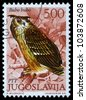 "YUGOSLAVIA - CIRCA 1980: A stamp printed in Yugoslavia shows the European Eagle Owl with the inscription ""Bubu bubo"" from the series ""Fauna"", circa 1980 - stock photo"