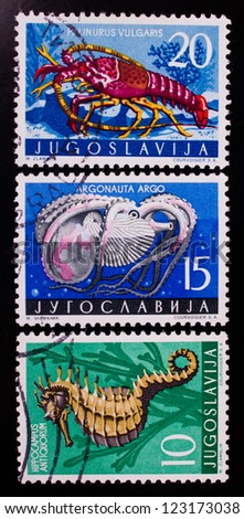 YUGOSLAVIA - CIRCA 1965 : A stamp printed in Yugoslavia shows three kinds of sea fish , circa 1965. - stock photo