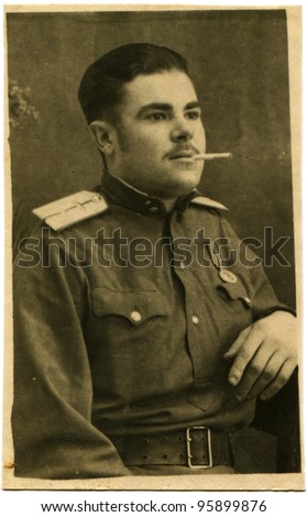 YUGOSLAVIA - CIRCA 1946: Portrait of the Air Force lieutenant with a cigarette in his mouth, the city Zagora, Croatia, Yugoslavia, circa 1946