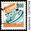 """YUGOSLAVIA - CIRCA 1986: Stamp printed in Yugoslavia shows a Telephone card, tokens and handset, without inscription, from series """"Postal Services"""" circa 1986 - stock photo"""