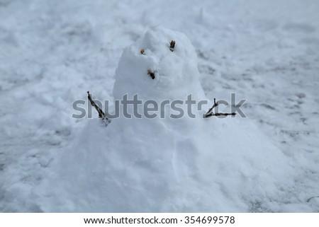Yukidaruma is a snowman. Snowman is a doll made with snow. - stock photo