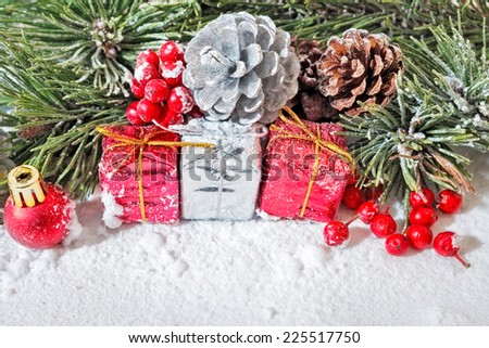 Yuletide image showing cones, red berries, pine leaves and snow